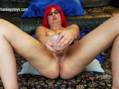 Red head Milf fucks her Boss Hogg dildo from Mr. Hankey's