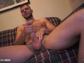 Wade Wolfe stroking his uncut monster cock
