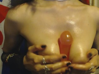 Goth Girl with Big Puffy Nipples Oils up and POV Titty Fucks Jelly Dildo