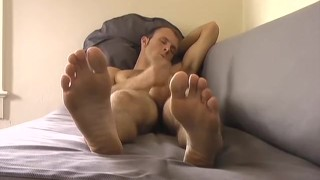 Handsome young stud jacks off with his feet in the forefront Bareback gay