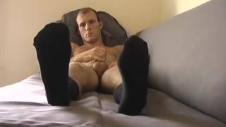 Handsome young stud jacks off with his feet in the forefront Fairy blowjob