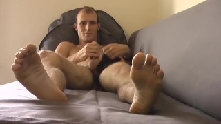 Handsome young stud jacks off with his feet in the forefront Dick dutch