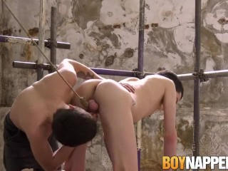 Tied up twink gets his dirty little mouth fed with dom dick
