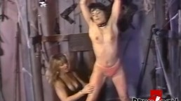 Lesbian femdom playing with her restrained submissive