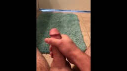 Hairy man strokes his cock until he cums
