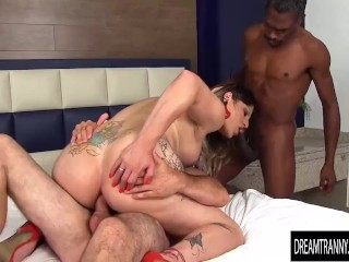 Three brunettes with long hair have a passionate lesbian sex play