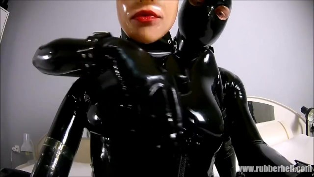 Young black couples nude - Rubber couple relaxing in full black latex enclosure