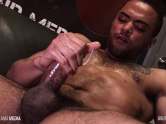 Tatted black hunk cums from his big cock