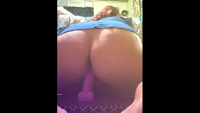 Curvy Slut rides her dildo. 19
