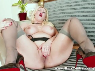 Curvy blonde Anna Joy masturbates in grey nylons and high heels after strip