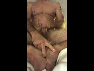 Stroking my cock and my feet.