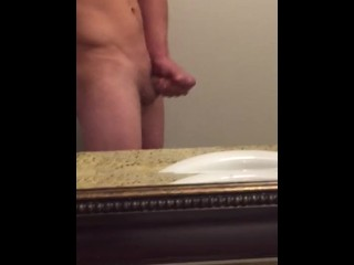 Solo jack off in bathroom mirror side view with cum