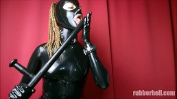 Full black rubber mistress teasing with truncheon