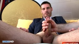 In suit straight banker gets wanked his big cock by guys in spite of him.