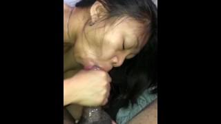 Amateur Asian milf sucks black cock  closeup blowjob sloppy deepthroat cumshot