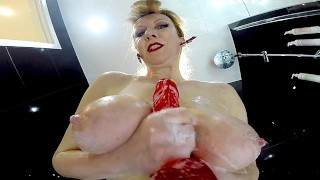 Redheaded Sluts Showers With Her Nylons On As She Rubs Her Twat