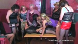 Older crossdressers with two attractive younger females