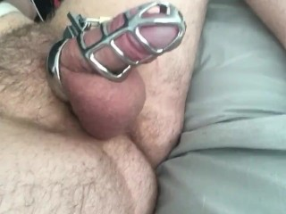 Big balls around in a chastity cock cage...