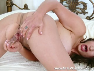 Brunette Tindra Frost strips down to her sheer pantyhose heels to fuck toy