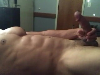 Hot ripped guy busts a nut all over his stomach