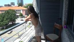 Brunette is hot masturbating on the balcony.
