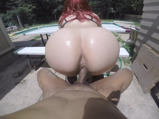 Big booty white girl bounces on BBC backwards in a chair poolside!
