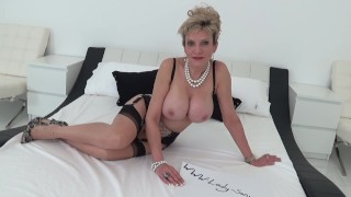 Mature blonde Lady Sonia plays with her tits while driving porno