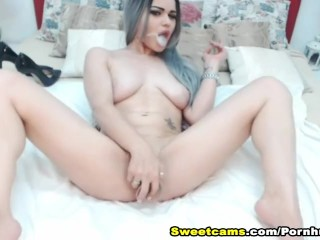 Pretty Babe Smoking While Fucking Herself on Cam