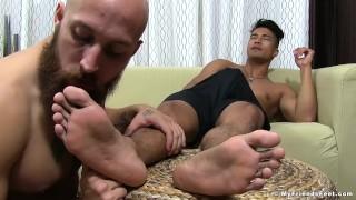 Asian Ken Ott jerks off while freaky homo slobbers his feet