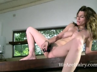 Johaquina masturbates with her sexy toy to orgasm