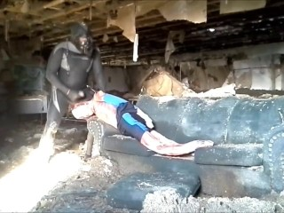Frogman captures his spandex enemy in abandoned building...