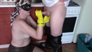 Handjob in rubber household gloves