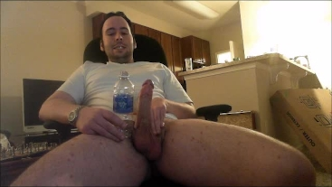 Hung throbbing monster's size comparison with water bottle