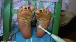 Ticklish feet in the tickle chair