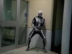 nighttime skeleton jerking off in front of outside doors