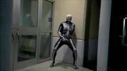 nighttime skeleton jerking off in front of outside doors