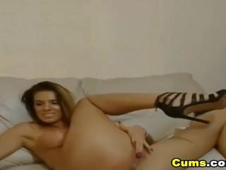 Pretty hot latina chick enjoys fucking herself...