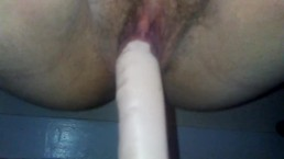 My fat pussy swallowing my dildo. Very load moaning.