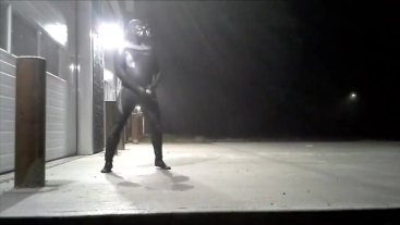 wrapped inside a lubed wetsuit frogman jerks off outside at industrial site