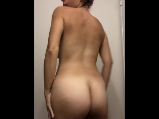 Latina smearing lotion on her body
