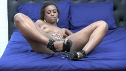 Simone Styles shows off her ebony legs in heels!