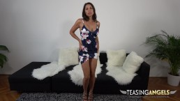 Stripping out of a flirty dress Zafira spreads her legs and rubs pussy