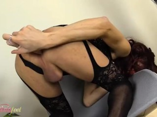 Redhead trap masturbates and shows her feet in black nylons