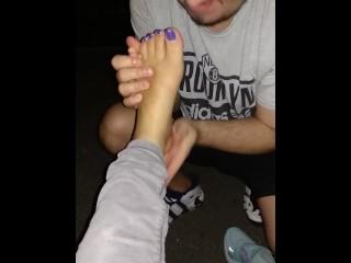 Street feet licking
