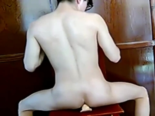 Boy riding a dildo