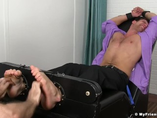 Good looking jock is ready for a bondage tickling session