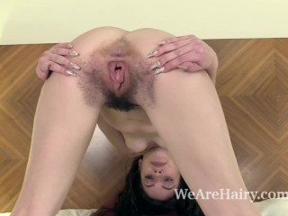 Anastasia strips naked on her bed