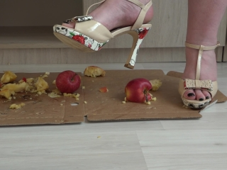 Crush fetish. Puffy legs in high-heeled shoes trample on apples.
