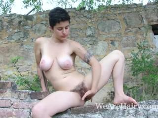 Sue has hot fun masturbating outdoors