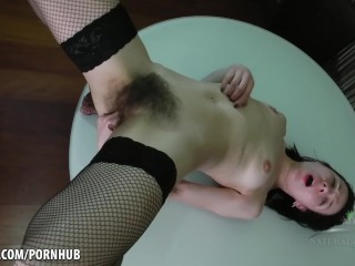 Liza James fingers her hairy pussy